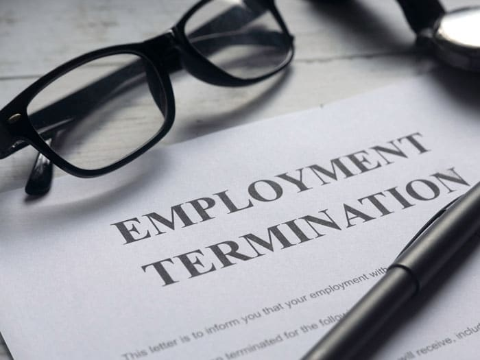 Employment termination papers laying on desk