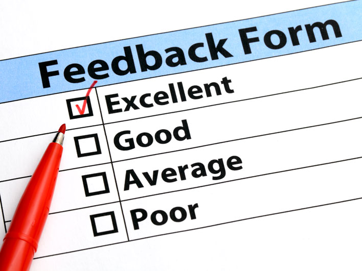 Red pen marking a feedback form